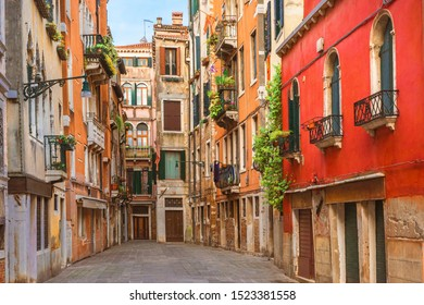 View of the old street in Venice with colorful Venetian houses in Venice, Veneto, Italy