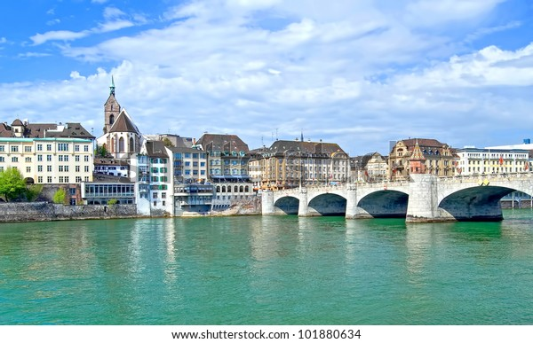 View of the old town of Basel, Switzerland with the River Rhine and the historic bridge and historic buildings