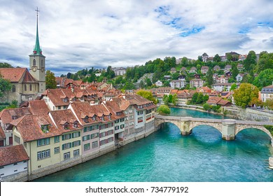 The view of Old town of Bern, Aare river and Untertor bridge with Nydegg church in the background.