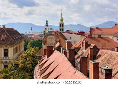 View of the old town center of Graz with the church Dreifaltigkeitskirche in the middle from the staircase of Castle Schlossberg Hill. Graz, Austria.