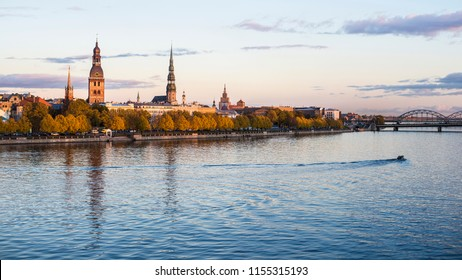 A view of the Old Town from the Daugava River promenade at sunset. Riga, Latvia
