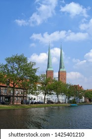 View of the old town embankment and Lübeck Cathedral from Trave river. Lubeck, Schleswig-Holstein, northern Germany. UNESCO World Heritage