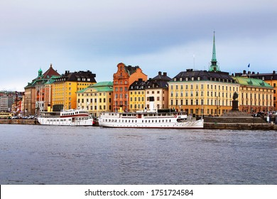 View of Old town (Gamla Stan), spire of German church and statue of King Gustav III of Stockholm (right), Sweden