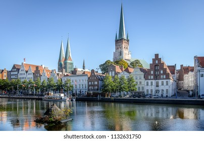 View of the old town of Luebeck city with steeples of St. Peter's Church and St. Mary's Church