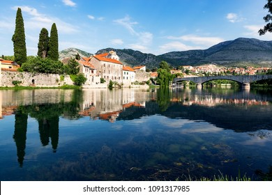 View of old town with reflection in river Trebisnjica, Trebinje. Bosnia and Herzegovina