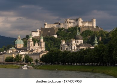 View of the old town of Salzburg and Hohensalzburg Castle shining in the evening sun