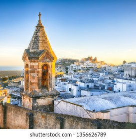 View of old town white town Ostuni and cathedral at sunrise. Brindisi, Apulia southern Italy. Europe.
