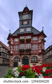 View of the old townhall of Heppenheim, Hesse, Germany with red and white. blooming flowers in front of it