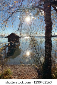 """View of an old wooden boathouse at the lake """"Ammersee"""" near Munich in Bavaria"""
