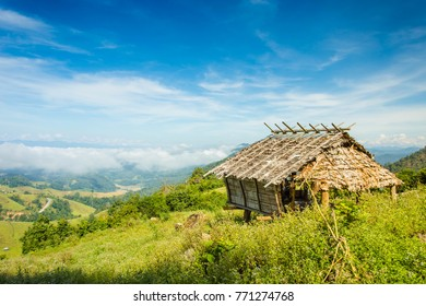 view of the old wooden hut in mountains and fog, Thailand