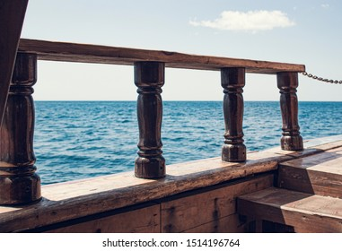 View from the old wooden ship on the sea horizon. Vintage ship with ancient attributes, as in the days of pirates