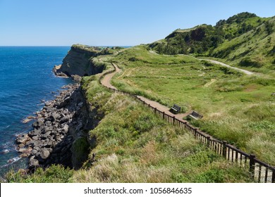 """View of Olle trail No. 10 Course in Songaksan in jeju island, Korea. Olle is famous trekking courses created along coast of Jeju Island. Songaksan is famous place for drama """"All-in"""" filming location."""