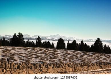 View on Alpes Mont Blanc mountains from Geneva Léman lake, col du marchairuz, Switzerland, Canton Vaud, stratus cloud, background, beautiful sky.