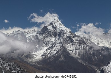 View on Ama Dablam peak with clouds and deep blue sky, one of the most beautiful mountains in Sagamartha national park, Khumbu region, Himalaya, Nepal