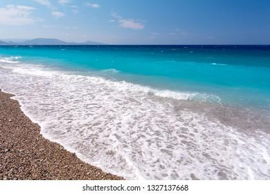 view on amazing Akti Miaouli Beach in Rhodes town, Greece