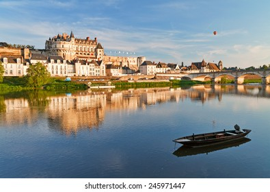 View on Amboise through Loire river at evening, France.