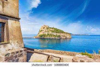 View on Aragonese Castle from Michelangelo or Guevara Tower. Castello Aragonese is most visited landmark and tourist destination near Ischia island, Italy.