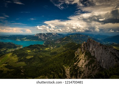 View on Attersee from top of Schafberg on a sunny day with dramatic cloudy blue sky