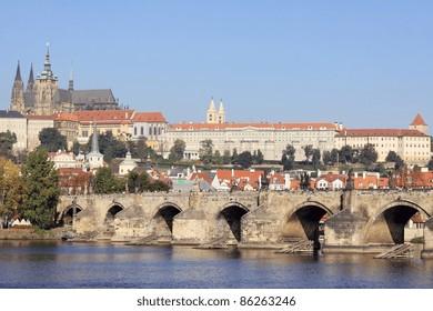 View on the autumn Prague gothic Castle with the Charles Bridge, Czech Republic