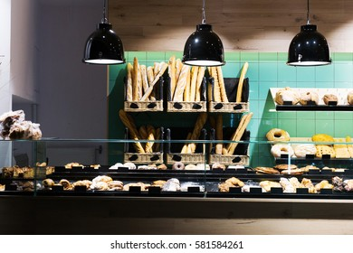 view on bakery counter with many different pastries and bread displayed