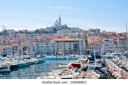 The view on basilica of Notre-Dame-de-la-Garde from the Old Port of Marseille.