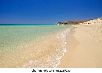 View on the beach Sotavento with golden sand and crystal sea water of amazing colors on Costa Calma on the Canary Island Fuerteventura, Spain.
