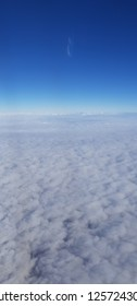 View on beautiful cloudy skies from a plane