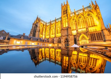 View on the beautiful illuminated cathedral with reflection in Metz during the twilight in Lorraine region of France