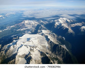 View on beautiful mountains with glaciers near Vancouver (Canada) from the plane