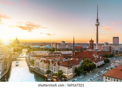 view on Berlin Cathedral over River and TV-Tower  at summer sunset