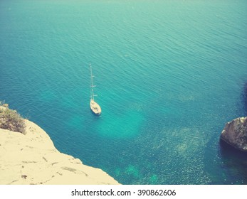 View on the blue Mediterranean sea from the rocky south coast of Malta.  Image filtered in faded, retro, Instagram style with extremely soft focus; nostalgic concept of summer holidays and travel.