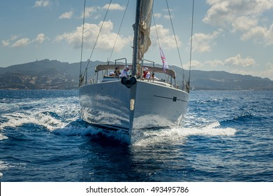 View on the bow of sailing yacht while cruising near Porto Cervo, Sardinia island, Italy.