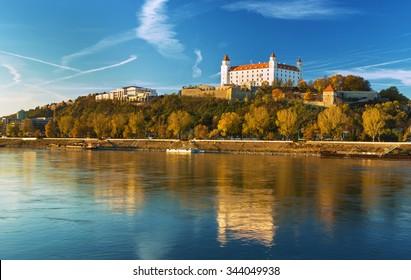 View on Bratislava castle,Parliament and Danube river in autumn sunset,Brarislava,Slovakia