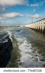 View on breakwater and old wooden pier, Sunday 19 November 2017, Nieuwpoort, Belgium.