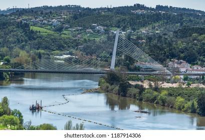 View on the bridge over Mondego river in Coimbra, Portugal