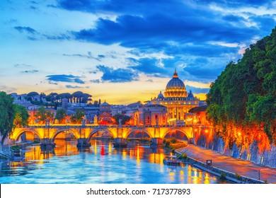 View on Bridge Vittorio Emanuele II (Ponte Vittorio Emanuele II) and Vatican city St. Peter's Basilica (Basilica di San Pietro) at night time. Rome. Italy.