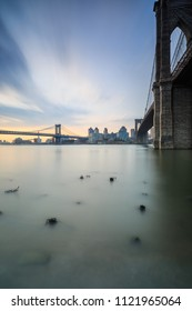 View on Brooklyn and Manhattan bridges from the broken pier during sunrise