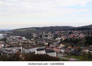 view on the buildings and houses from the roof top of the sparrenburg in bielefeld germany photographed during a sightseeing tour at a sunny day