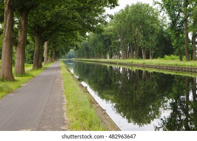 view on canal with trees along border