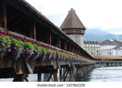 View on the Chapel bridge and the water tower in Lucerne