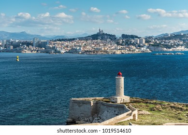 View on the Chateau d'If Lighthouse on Castle IF fortress-island with Marseille in the background, Provence, France. The chateau was made famous by the Alexandre Dumas novel The Count of Monte Cristo.