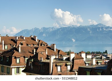 View on Chemin de Mornex and Alps seen from Esplanade de Montbenon in Lausanne, Switzerland.