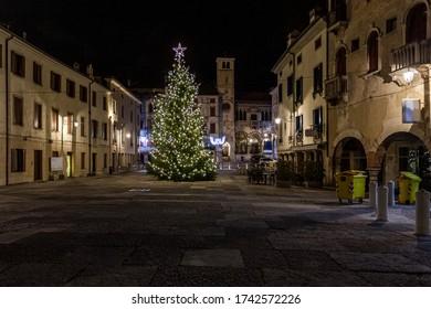 View on Christmas tree in beautiful medieval town square, Vittorio Veneto, Italy. Concept: Italian historic centers, urban panoramas, urban Christmas decorations