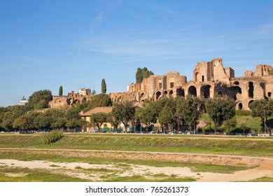 View on the Circus Maximus terrain and the ruins of the Temple of Apollo Palatinus in Rome, Italy. Shot in afternoon sunlight and set against a clear blue sky.