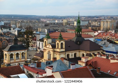 View on the city and Church of the Blessed Virgin Mary from Ratusha or Town Hall - building in city center on Rynok or Market Square in Ivano-Frankivsk city, Ukraine