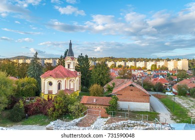View on the city from Diosgyor Castle in Miskolc, Hungary. A contrast between an old church and archietcture and Soviet style block buildings.