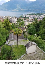 View on the city of Locarno and on the facing overlooking mountains - including Monte Tamaro - on a cloudy Spring day from Madonna del Sasso viewpoint