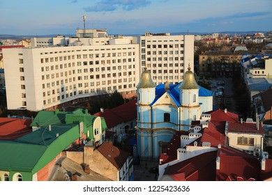 View on city from Ratusha or Town Hall in Ivano-Frankivsk city, building in center of Ivano-Frankivsk city on Rynok or Market Square. Blue Armenian Church