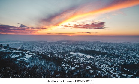 View on a city under the colorful sky on a winter sunny day. Vrsac, Serbia.