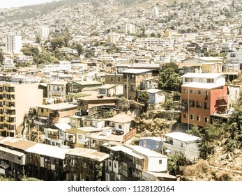 View on Cityscape of historical city Valparaiso, Chile. The colorful houses and hectic street in Valparaiso. It is the most important seaport in Chile. Image with vintage and yesteryear effect